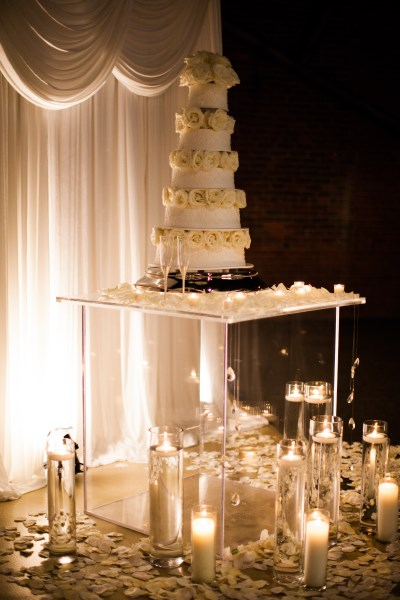 cake table, candles, flowers