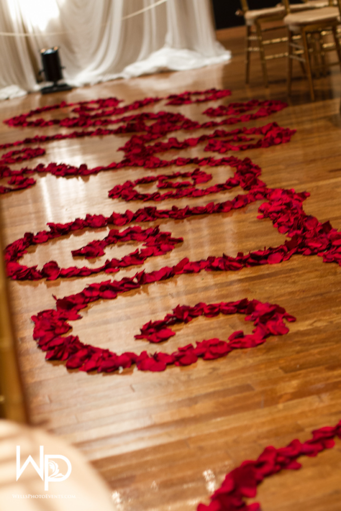 rose petal aisle design, red
