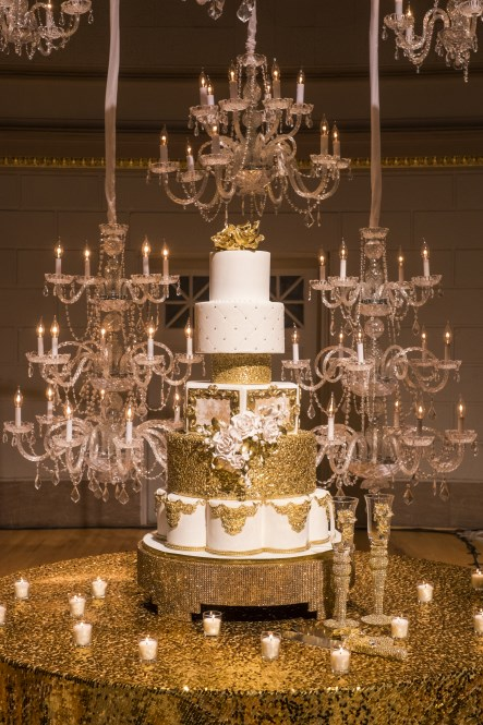 gold wedding cake, cake table, chandeliers