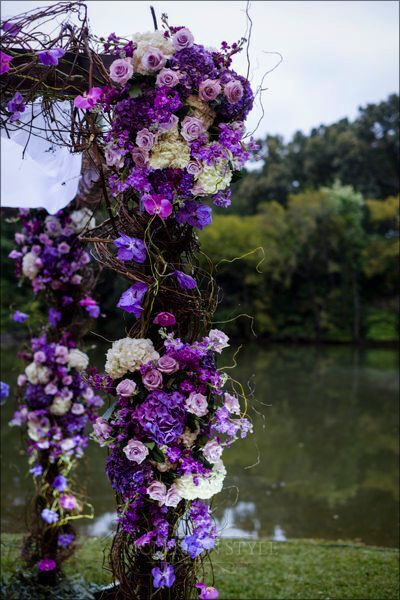 chuppah, branches and purple flowers