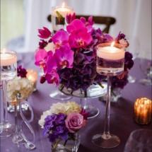 purple wedding centerpieces,candles, purple wedding