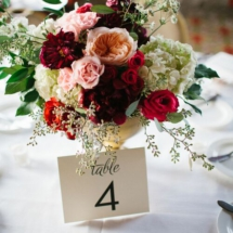 red, pink, greenery, centerpiece