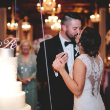 cake cutting, lace wedding dress, bow tie