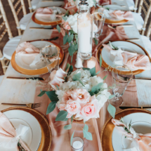 tables cape, pink linens, plate settings, centerpieces