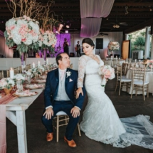 bride, groom, outside reception, centerpieces