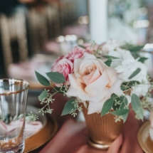 small centerpiece, spray roses, roses, greenery